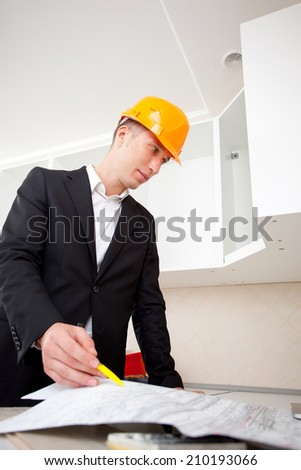 an engineer studying a plan to build and reflects - stock photo