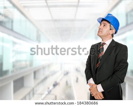 An engineer with blue hat at the office - stock photo