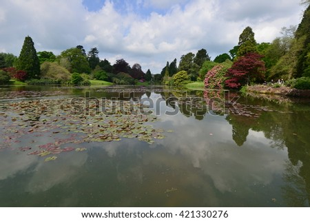 An English country garden with a lake in late springtime.