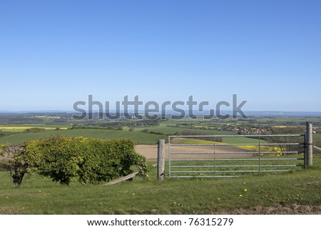 an english landscape with views over the patchwork fields of the yorkshire wolds under a clear blue sky