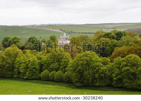 An English Rural Landscape with country House set amongst the trees