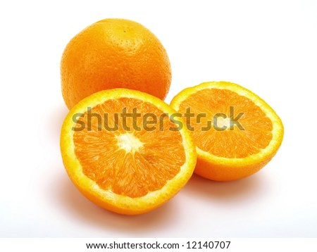 An entire and two half oranges put together on a white table - stock photo
