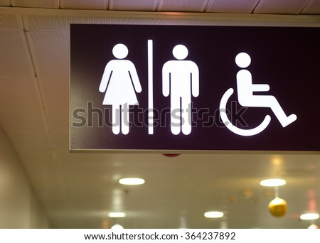 An entrance to the male and female toilet, toilet for the disabled - stock photo