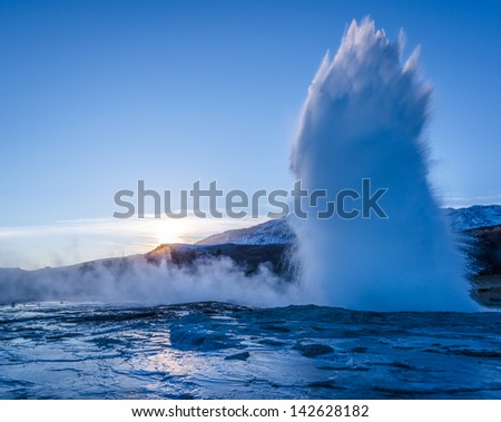 An erupting geyser at the Geysir national park in Iceland.