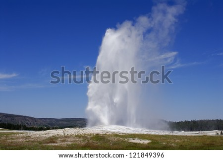 An eruption of the Old Faithful geyser in the Yellowstone National Park. USA - stock photo