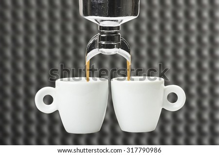 An espresso machine group head  and two cup - stock photo