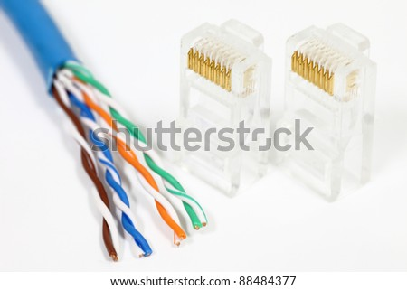 An ethernet cable wire ready to be assembled with loose RJ45 heads on white - stock photo