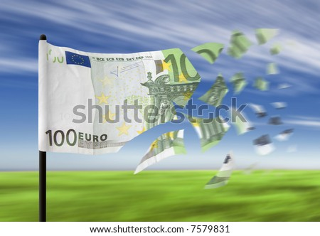An euro banknote paper money falling into pieces in the wind denoting a financial crisis. - stock photo