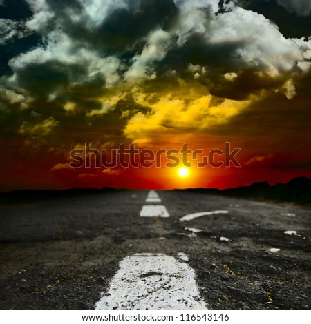 an evening motor car route thrue the field - stock photo