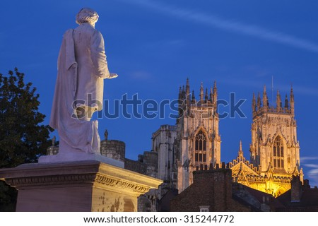 An evening view of the William Etty statue and York Minster in York, England. - stock photo