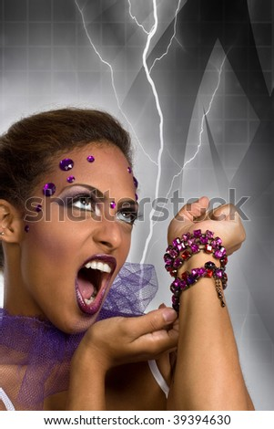 An evil queen with glamorous makeup shooting lightning from her hand. - stock photo