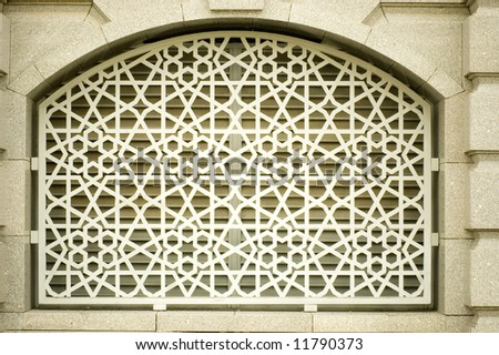 An example of Islamic design cast in concrete on a building in Putrajaya, Malaysia. - stock photo