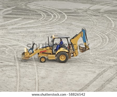 an excavator truck parked on the sand - stock photo