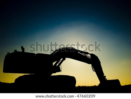 An Excavator with backlight - stock photo