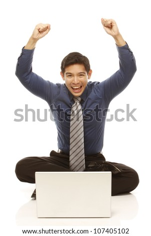 An excited businessman in front of a laptop (isolated on white) - stock photo