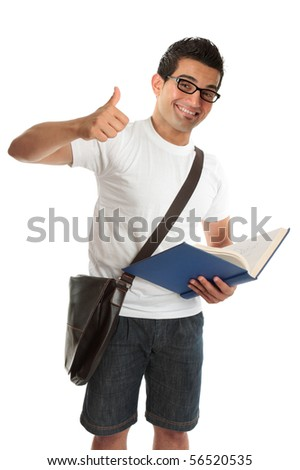 An excited happy university or college student, holding a text book and with thumbs up approval success, hand sign gesture.  White background. - stock photo