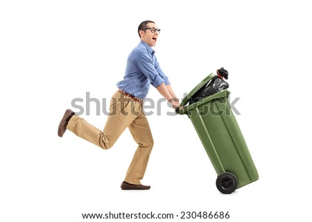 An excited man pushing a garbage can isolated on white background - stock photo