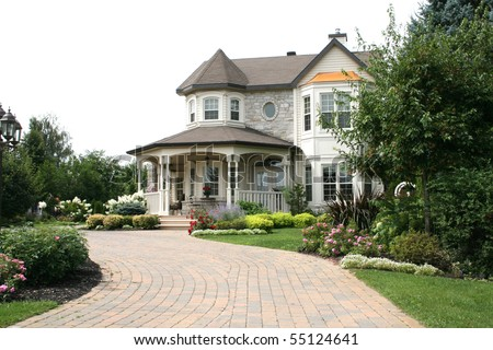 An Executive House with Circular Driveway - stock photo