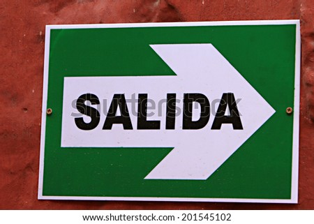 An exit sign in Spanish -  Santa Catalina convent in Arequipa, Peru