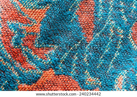 An exotic brown color Javanese floral pattern weaved fabric as textural background. - stock photo