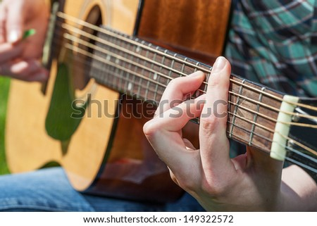 An experienced musician playing the classic guitar - stock photo