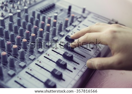 An expert adjusting audio mixing console. Music Studio - stock photo