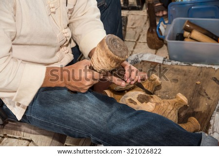 an expert wood carving doing his work