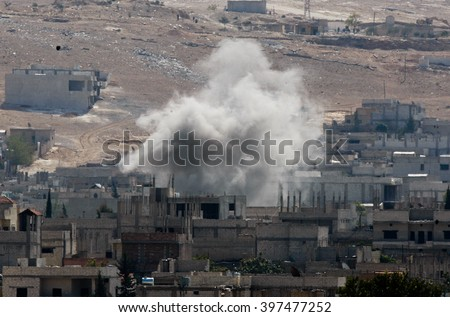 An explosion after an apparent US-led coalition airstrike on Kobane, Syria, as seen from the Turkish side of the border, near Suruc district. 17 October 2014, Turkey , Syria.
