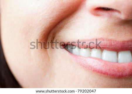 An extreme close up of a beautiful smile from a young lady