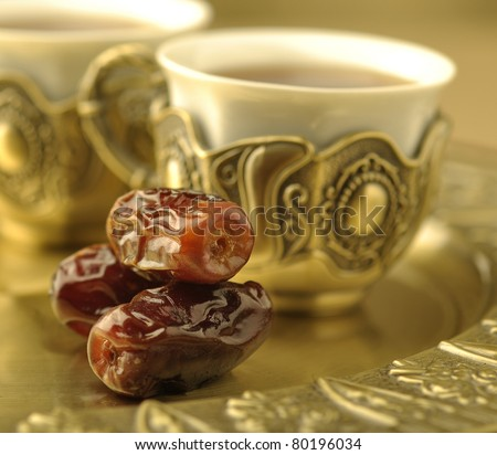 An extreme close up of dates with arabic tea cup - stock photo
