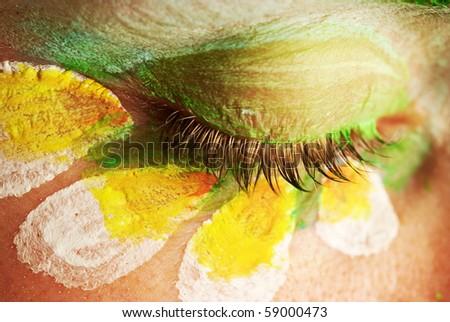 An eye of beautiful woman with creative makeup - stock photo