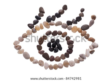An eye symbol made out of small stones isolated on the white - stock photo