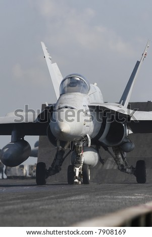 An F/A-18C Hornet Awaits Catapult Assisted Takeoff on the Nuclear Aircraft Carrier, USS Enterprise - stock photo