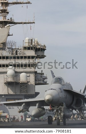 An F/A-18C Taxis for Launch on the Nuclear Aircraft Carrier, USS Enterprise - stock photo