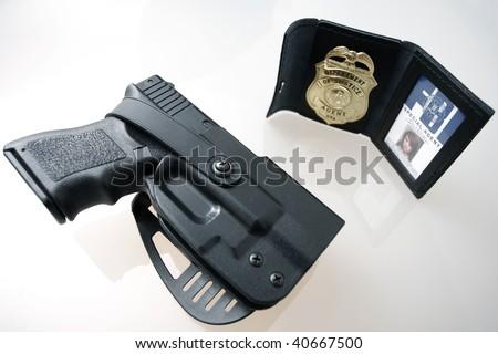 An fbi badge and pistol on a table stock photo - Fbi badge wallpaper ...