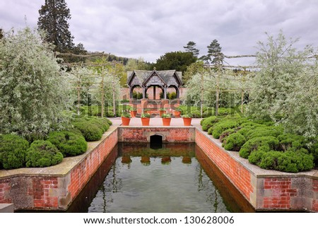 An Formal Landscape garden with water feature and gazebo - stock photo