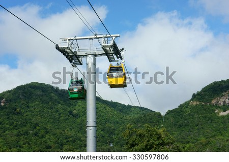 AN GIANG, VIET NAM- OCT 16: Nui Cam nature reserve, an tourist area near by Chau Doc, Mekong Delta, suspension cable system to transport traveler up to mountain, Angiang, Vietnam, Oct 16, 2015 - stock photo