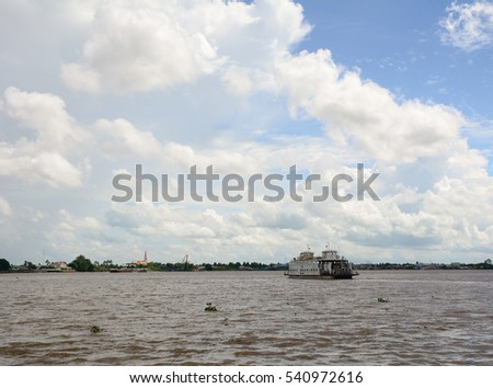 An Giang, Vietnam - Aug 7, 2016. A ferry on the Mekong River in Southern Vietnam. The Mekong is a trans-boundary river in Southeast Asia. It is the world's 12th-longest river.