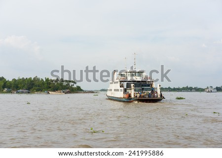 An Giang, Vietnam - Nov 29, 2014: Wide view of river scenery with a ferry boat carries people across Tien river in Mekong delta, southern Vietnam