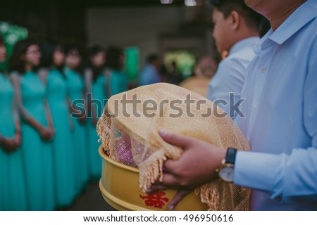 An Giang, Vietnam - September 30th, 2016: close-up man are carrying wedding gift box front door bride