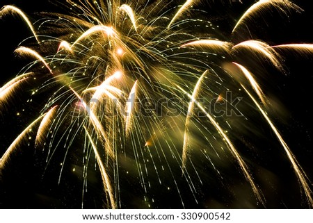 an gold firework explosion in the night sky - stock photo