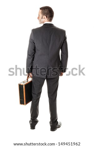 an handsome businessman with a briefcase isolated over a white background - stock photo