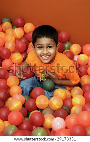An handsome Indian kid having fun at a birthday party - stock photo