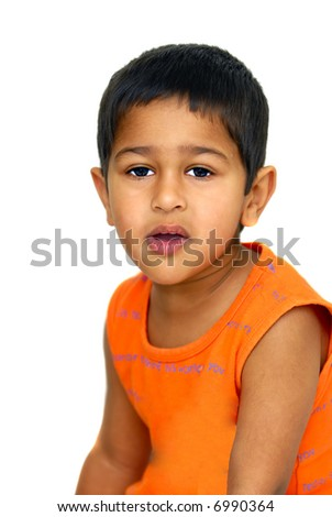 an handsome Indian kid not looking happy - stock photo