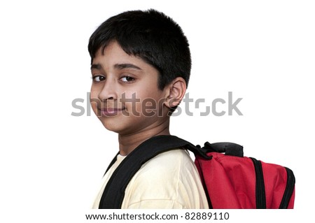 An handsome Indian kid ready to go back to school - stock photo