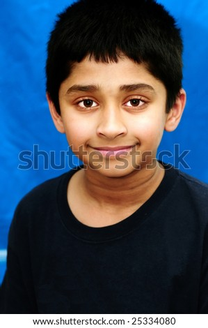 An handsome Indian kid smiling and looking happy - stock photo