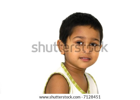 An happy  handsome indian kid smiling nicely - stock photo