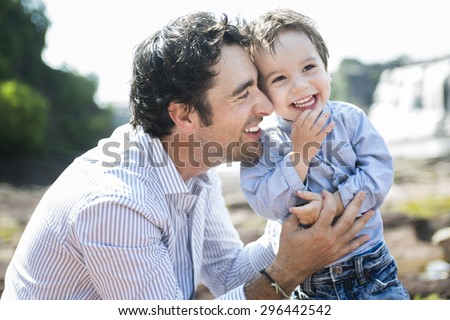 An happy joyful father having fun with is child - stock photo