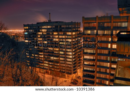 An HDR night image of a Montreal appartment complex. - stock photo