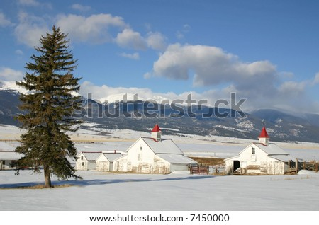 An historic Colorado Ranch in the Wet Mountain Valley after winter snowfall. - stock photo